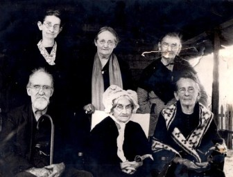 "Pictured Standing (left to right): 1. Josephine Bolton Tabor--daughter of Eljah and Eliza Bolton, wife of Robert J. Tabor 2. Mary George Washington ""Mollie"" Butler--daughter of Mary Edmonds and George Tabor, wife of George Algernon Butler 3. Matilda Edmonds Elliott--daughter of James Edmonds and Grissella Ann Hay, sister to Mary Edmonds, wife of William Henry Elliott Pictured seated (left to right): 1. Robert J. ""Bob"" Tabor--son of Elijah Tabor and Susan Sims, brother-in-law to Mary Edmonds 2. Mary Edmonds--daughter of James Edmonds and Grissella Ann Hay, wife of (1) George W. Tabor, (2) Daniel Webster Lee 3. Penniah Edmonds Buckley--daughter of James Edmonds and Grissella Ann Hay, sister to Mary Edmonds, wife of Andrew J. Buckley."